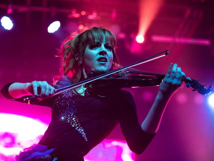 Lindsey Stirling wields a rapid-fire bow onstage at the Marquee Theatre during her concert , Tuesday, May 27, 2014. The Gilbert woman has her latest album debuting at number two.