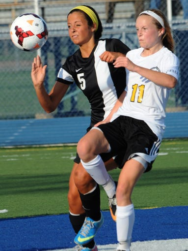 Sussex Tech forward Natalie Sava and Anne Brush of Padua charge after a loose ball in match Friday night in Dover.