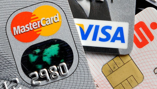 Credit and bank cards with electronic chips are shown in Gelsenkirchen, Germany.