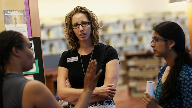 (Center) Veronica Gabbard, a board member for the Center of Wellness for Urban Women, chats with guests, Thursday, June 18, 2015, at the Indianapolis Central Public Library, Indianapolis, Ind. This year's event is June 13.