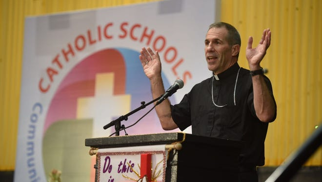 In this Feb. 3, 2017, file photo, Archbishop Michael Jude Byrnes delivers the keynote address during the Catholic Educators' Conference at the Father Duenas Memorial School Phoenix Center.