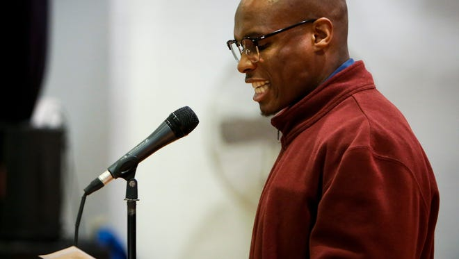 Prison inmate Diarra Bryant reads a poem Tuesday, Dec.. 5, 2017, at the Richard A. Handlon Correctional Facility in Ionia as part of the Free Verse Arts Project Poetry Slam.   Inmates and students from MSU's The Residential College in the Arts and Humanities met weekly for a semester to learn about and write poetry.  The project was started by RCAH instructor Guillermo Delgado.
