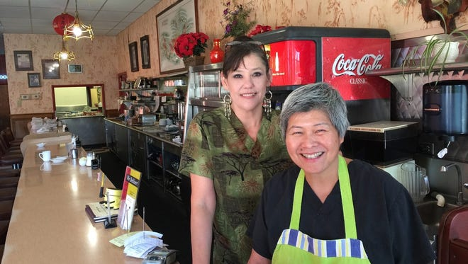 Jeannie Lim, right, and server Dawn Coleman at Lim's Cafe.