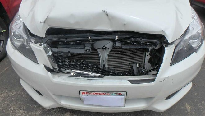 A sedan that collided with a deer recently awaits repairs at Goff's Collision Repair Center in Waukesha. The business has received  a steady stream of vehicles in need of repairs after colliding with deer.