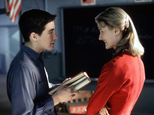 "Jake Gyllenhaal, left, and Laura Dern in a scene from the film ""October Sky."""