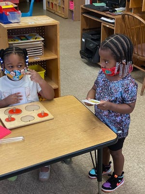 The city of Savannah's W.W. Law Learning Center and Windy's Preschool, which fall under the jurisdiction of the Greenbrier Children's Center, are both operating at Windy's on Tattnall Street. Staff is seeing to it that the rules outlined in Gov. Brian Kemp's most recent child-care executive order are being followed. Shown are two young students wearing face masks.