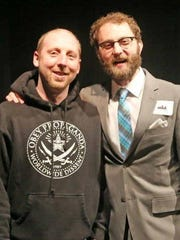Artist Chris Vance, left, was recognized for his contributions to downtown Des Moines and the Downtown Chamber's fifth annual celebration March 3 at Des Moines Social Club. He is pictured with Scott Siepker.