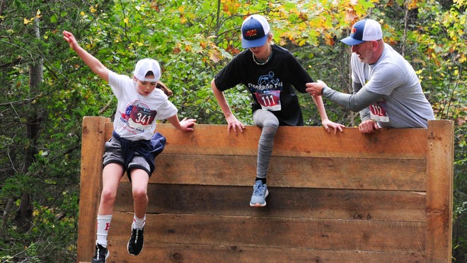 Participants tackle an obstacle during the Renegade Run, organized by Type One, a Hingham non-profit aimed at raising money and awareness for type one diabetes. The race will be virtual this year. Photo from Type One.