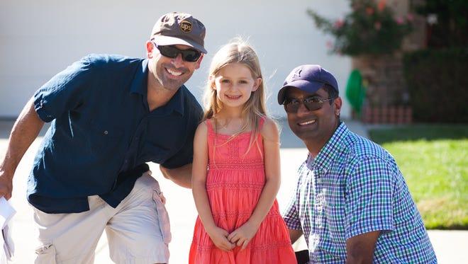 "From left, David Horowitz, Addison Aguilera, 7, and Nick Sivakumaran on the set of ""The Lemonade Stand."""