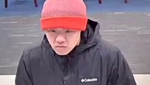 Authorities allege Brandon Cheng of Cherry Hill is the man photographed during the Jan. 31 robbery of a Fulton Bank.