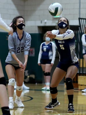 Eyleen Dias eyes (right) eyes the return during Plymouth North's match against Marshfield.