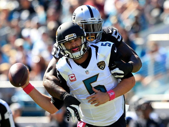 JACKSONVILLE, FL - OCTOBER 23: Blake Bortles #5 of the Jacksonville Jaguars is tackled by Bruce Irvin of the Oakland Raiders during the game at EverBank Field on October 23, 2016 in Jacksonville, Florida. (Photo by Rob Foldy/Getty Images)