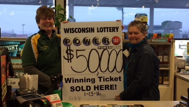 Lou's One Stop manager Nancy Neuberger, left, and assistant manager Pat Devleeschower celebrate selling a $50,000 Powerball ticket.