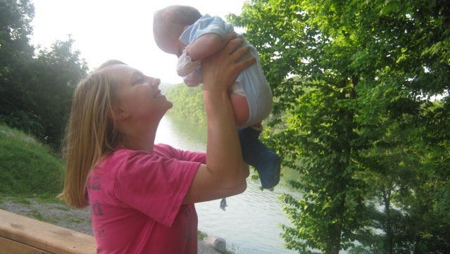 Lacey holds her son, Christian, as a baby.