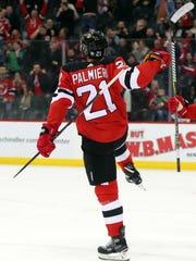 New Jersey Devils right wing Kyle Palmieri (21) celebrates
