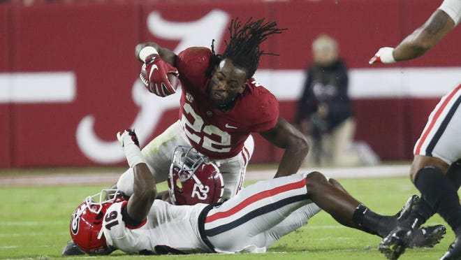 Oct 17, 2020; Tuscaloosa, Alabama, USA; Georgia defensive back Lewis Cine (16) takes down Alabama running back Najee Harris (22) who loses his helmet on the play during the first quarter at Bryant-Denny Stadium. Mandatory Credit: Gary Cosby Jr/The Tuscaloosa News via USA TODAY Sports