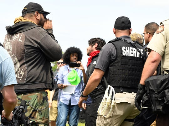 A counter protester is arrested in downtown Newnan,