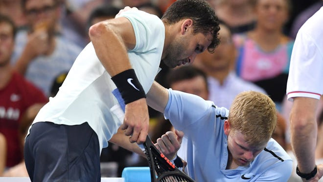 Grigor Dimitrov helps Kyle Edmund, who fell down with a injury during their men's quarterfinal match.