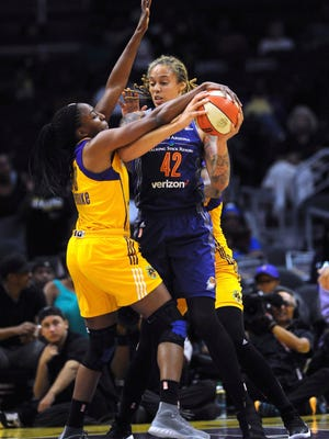 Los Angeles Sparks forward Nneka Ogwumike (30) tries to get the ball from Phoenix Mercury's Brittney Griner (42) during the first half of a WNBA basketball playoff game Tuesday, Sept. 12, 2017, in Los Angeles. (Stephen Carr/Los Angeles Daily News via AP)