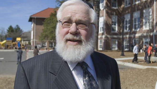 Rabbi Meir N. Hertz, dean of the Tashbar school in Lakewood, stands in front of the school's former location on Princeton Avenue in 2008.