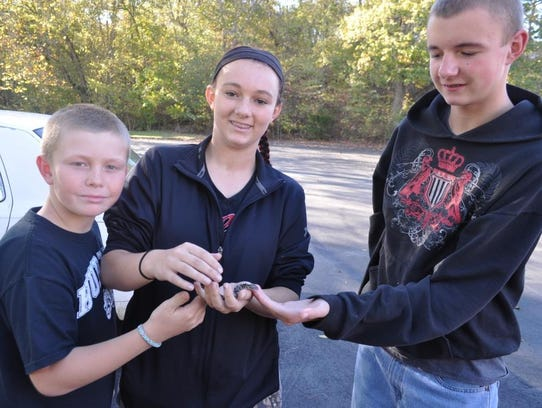Terry Lowery, right, shows off the two-headed snake