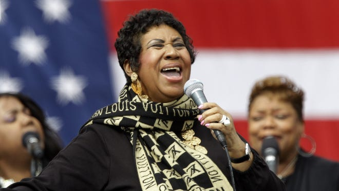 Aretha Franklin performs prior to President Barack Obama speaking in Detroit, Monday, Sept. 5, 2011. Obama's speech at the annual event was serving as a dress rehearsal for the jobs address he's delivering to a joint session of Congress on Thursday night. (AP Photo/Paul Sancya) ORG XMIT: MIPS112 [Via MerlinFTP Drop]