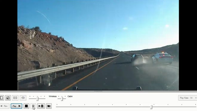 A screenshot from a Utah Highway Patrol dashboard camera video shows a trooper attempting to stop a vehicle that fled officials March 1, 2018.