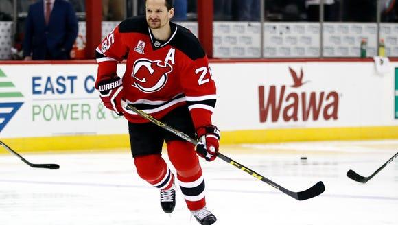 New Jersey Devils' Patrik Elias skates with the team