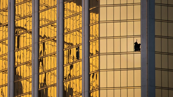 LAS VEGAS, NV - OCTOBER 3: A window is broken on the 32nd floor of the Mandalay Bay Resort and Casino where a gunman opened fire on a concert crowd on Sunday night, October 3, 2017 in Las Vegas, Nevada. The gunman, identified as Stephen Paddock, 64, of Mesquite, Nevada, allegedly opened fire from a room on the 32nd floor of the Mandalay Bay Resort and Casino on the music festival, leaving at least 58 people dead and over 500 injured. According to reports, Paddock killed himself at the scene. The massacre is one of the deadliest mass shooting events in U.S. history. (Photo by Drew Angerer/Getty Images)