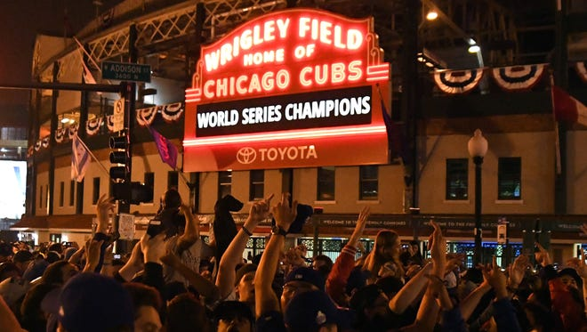 Chicago Cubs fans celebrate the team's 2016 World Series championship.