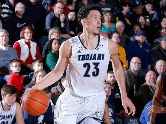 East Lansing's Brandon Johns was the AP Class A player of the year and led the Trojans to a 24-1 mark that included CAAC Blue and regional titles.