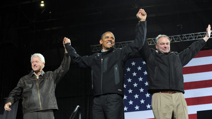 Former president Bill Clinton, President Obama and Tim Kaine wave at supporters during a campaign rally in 2012. Kaine told the Associated Press he's reaching out to Republicans to find ways to work with them should he and Hillary Clinton win the Nov. 8 presidential election.