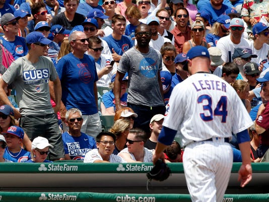 Chicago Cubs fans react as starting pitcher Jon Lester walks off the field during the first inning of a baseball game against the Pittsburgh Pirates, Sunday, July 9, 2017, in Chicago. (AP Photo/Nam Y. Huh)