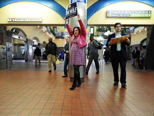 Mary Isenhour yells support for Tom Wolf on Election Day last November as he greets travelers at the 69th Street Transportation Center in Philadelphia. Isenhour was announced as Wolf's new chief of staff Thursday, July 23, 2015.