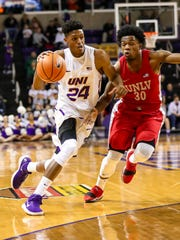 UNI's Isaiah Brown drives to the basket during the