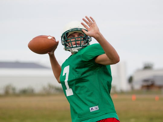 Wyatt Richtmyre looks to throw the ball at Almond-Bancroft football practice on Thursday, Aug. 6, 2015.