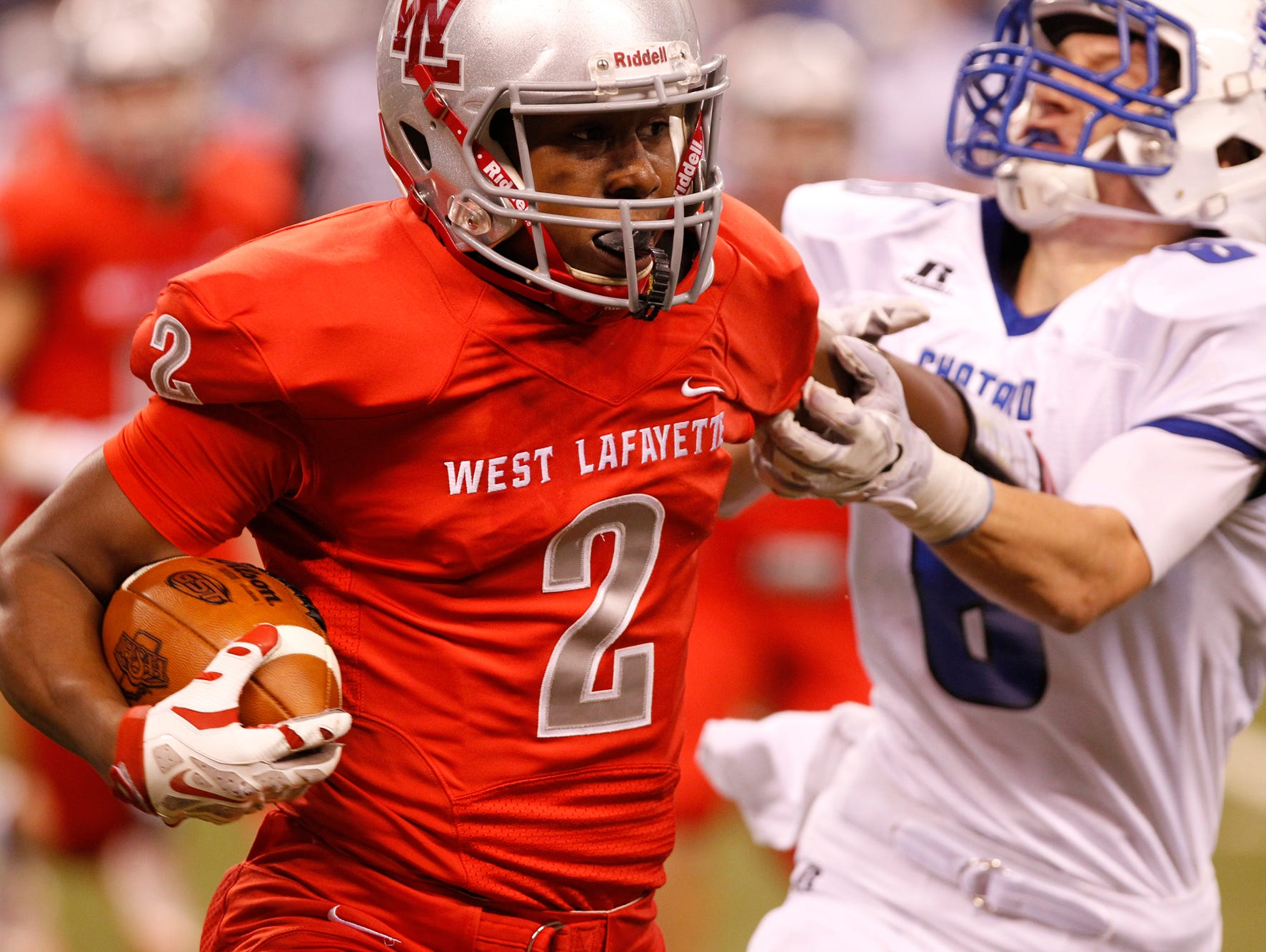 Nai Carlisle with a carry for West Lafayette against Bishop Chatard in the Class 3A state finals Friday, November 27, 2015, at Lucas Oil Stadium in Indianapolis. West Lafayette fell to Bishop Chatard 31-7.