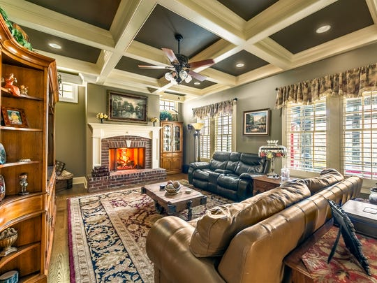 Stars of the spacious family room include the coffered