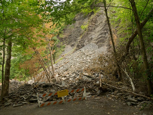 An estimated 1,000 tons of rocks block the Gorge Trail at Taughannock Falls State Park after the controlled collapse in June of a large, hanging rock structure above the trail.