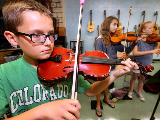 Beau Eerebout, 12 plays a violin during a strings camp