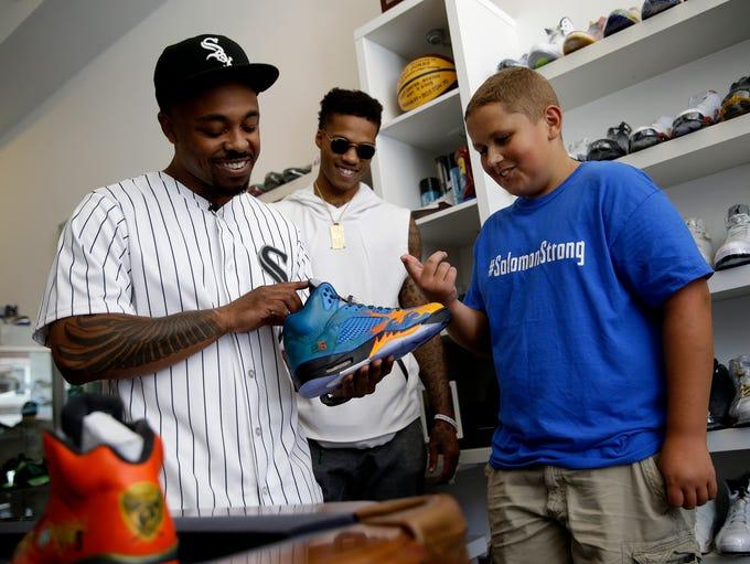 Carl Bradley, left, co-owner of The Luxury Sneaker