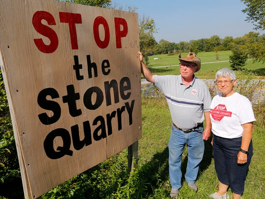 Bill and Kay Miller, opponents of a proposed stone quarry, in their front yard Wednesday, September 20, 2017, near Americas. The Millers live across Ind. 25 from where the entrance to the quarry would be located.