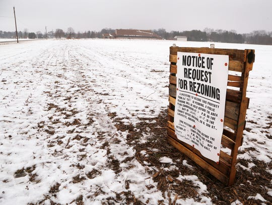 Notice of Request for Rezoning sign posted in a farm