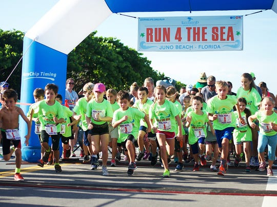 The benefit Run 4 The Sea race includes a four-mile run for adults at 7 a.m. and a one-mile kids' fun run at 8:15 a.m. Pictured is the start of last year's kids' fun run.