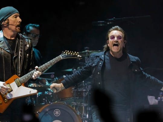 """Guitarist The Edge, left, and singer Bono, of the band U2, perform on stage during their """"eXPERIENCE + iNNOCENCE Tour"""" at Capitol One Arena on Sunday, June, 17, 2018, in Washington. (Photo by Brent N. Clarke/Invision/AP)"""