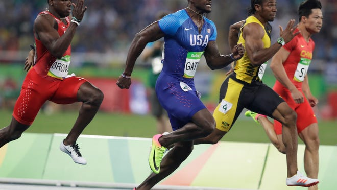 FILE - In this Aug. 14, 2016, photo, from left, Bahrain's Kemarley Brown, United States' Justin Gatlin, Jamaica's Yohan Blake and China's Su Bingtian compete in a men's 100-meter semifinal during the athletics competitions of the 2016 Summer Olympics in Rio de Janeiro, Brazil.