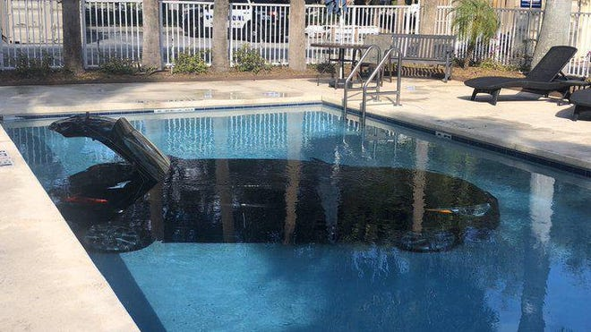 Two people escaped injury as their car went into a hotel pool in West Palm Beach Friday afternoon.