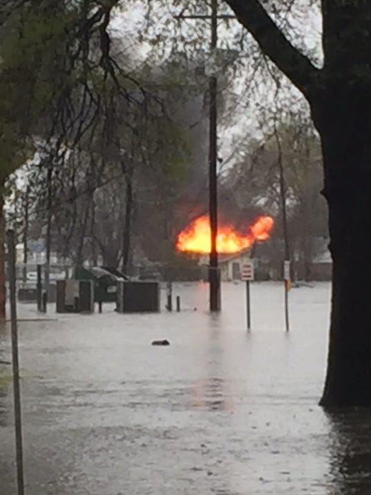 House fires hit flooded neighborhoods