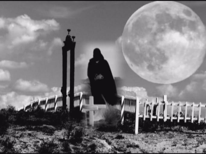 Grim Reaper visits cemetery