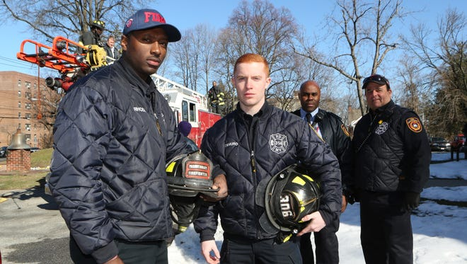 Mount Vernon probationary firefighters Michael Rhodd and Frank DeMuro Jr., are pictured outside of Fire Headquarters along with Capt. Kim Odindo and Firefighter Joseph Carroll, March 23, 2017.